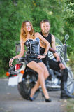 Portrait of attractive couple bikers on a motorbike Royalty Free Stock Photography