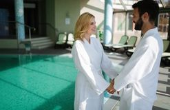 Portrait of attractive couple in spa center royalty free stock photos