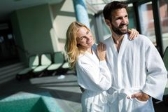 Portrait of attractive couple in spa center royalty free stock images