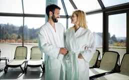 Portrait of attractive couple in spa center stock image