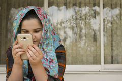 Portrait of Attractive Cute Muslim Girl Working With Smart Phone Royalty Free Stock Photography