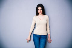 Portrait of attractive cute woman over gray background Royalty Free Stock Image