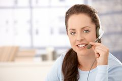 Portrait of attractive dispatcher with headphones Royalty Free Stock Images