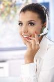 Portrait of attractive dispatcher smiling. Portrait of attractive young female dispatcher working, smiling stock photos