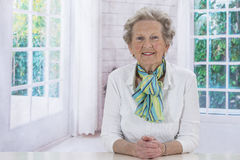 Portrait of an attractive elegant senior woman relaxing at home. Royalty Free Stock Photography