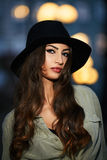 Portrait of attractive elegant young woman with black hat Stock Photo