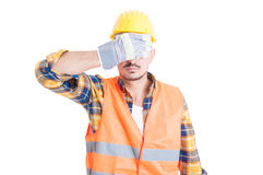Portrait of attractive engineer covering his eyes Stock Photography