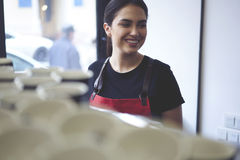 Portrait of attractive female barista working in cafeteria Royalty Free Stock Photography