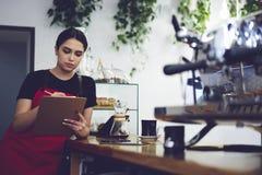 Portrait of attractive female barista working in cafeteria Stock Photo