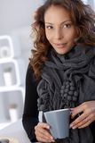 Portrait of attractive female drinking tea Stock Photography