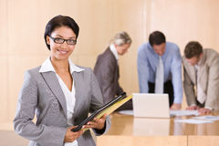 Portrait of attractive female executive. In the boardroom Stock Photography