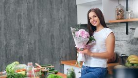 Portrait attractive female posing with rose composition at cosiness cuisine looking at camera