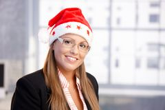 Portrait of attractive female in santa claus hat Stock Photography