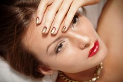 Portrait of attractive girl with beautiful spiral Minx nails Royalty Free Stock Images