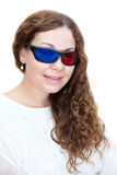Portrait of attractive girl with curly hair dressed with 3D glasses Royalty Free Stock Image