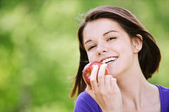 Portrait of attractive girl eating Royalty Free Stock Images
