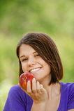 Portrait of attractive girl eating apple Royalty Free Stock Images