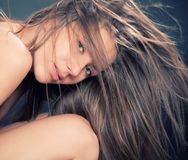 Portrait of attractive girl with fly-away hair Stock Images