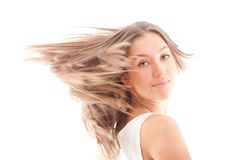 Portrait of attractive girl with fly-away hair Stock Photo