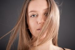Portrait of attractive girl with fly-away hair Royalty Free Stock Photos
