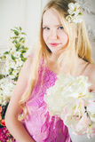 Portrait of attractive girl with long hair with a flowers. Portrait of attractive girl with long hair with a bouquet of flowers Stock Photos