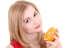 Portrait of attractive girl with orange over white Royalty Free Stock Photography