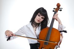 Portrait of attractive girl playing cello Royalty Free Stock Photo
