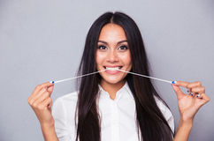 Portrait of attractive girl pulling bubblegum Stock Images