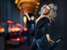 Portrait of attractive girl running in the downtown Stock Image