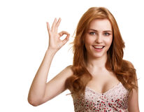 Portrait of attractive girl showing okay symbol Stock Photography