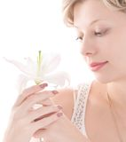 Portrait of attractive girl smelling white lily Royalty Free Stock Photography