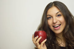 Portrait of attractive girl smiling with red apple in her hand healthy fruit Stock Image