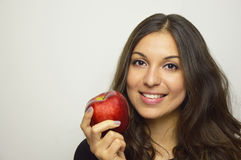 Portrait of attractive girl smiling with red apple in her hand healthy fruit Stock Images