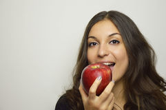 Portrait of attractive girl smiling with red apple in her hand healthy fruit Stock Photography