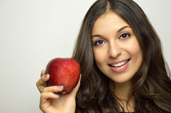 Portrait of attractive girl smiling with red apple in her hand healthy fruit Stock Photo