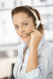 Portrait of attractive girl using headphones Stock Images