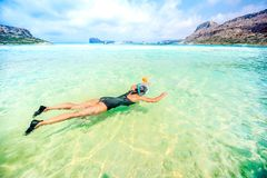 Portrait of attractive girl wearing black swimsuit and snorkling in clear ocean water. Portrait of attractive girl wearing swimsuit and snorkling in clear ocean Royalty Free Stock Images