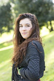 Portrait of attractive girl, the wind fluttering hair, outdoor. Royalty Free Stock Images