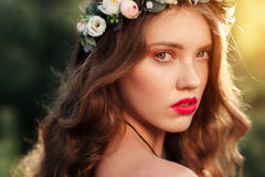 Portrait of attractive girl in wreath at sunset Stock Image