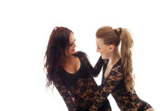 Portrait of attractive girls laughing in studio Royalty Free Stock Images