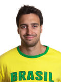 Portrait of an attractive guy with brazilian jersey Royalty Free Stock Photos