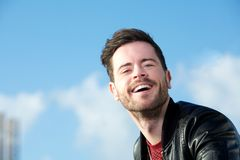 Portrait of an attractive guy laughing outdoors Stock Photography
