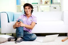Guy at home Stock Image