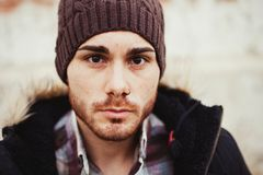 Portrait of attractive guy with wool hat in a old house. Royalty Free Stock Photo