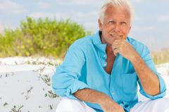 Portrait of Attractive Handsome Senior Man on Beach Stock Images