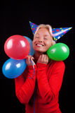 Portrait of attractive happy blonde with balloons. Young happy attractive girl with colorful balloons on party Stock Photo