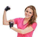 Sportswoman showing biceps. Portrait of attractive healthy smiling woman showing biceps royalty free stock photos