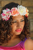 Portrait of an attractive hispanic woman with flowers in her hair Royalty Free Stock Photography