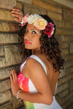 Portrait of an attractive hispanic woman with flowers in her hair Stock Image