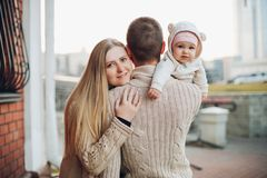 Young happy family smiling at camera and standing together. royalty free stock photo